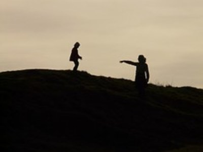 Adult and child on hill