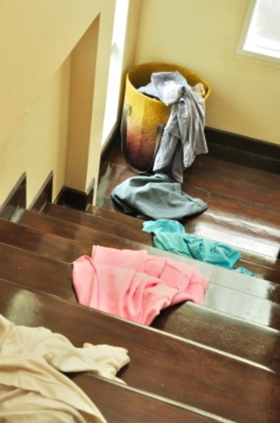 Clothes strewn over stairs