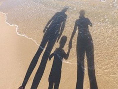 Family shadows on the beach