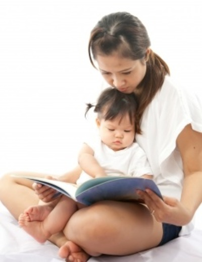 Mother Reading Book with Baby